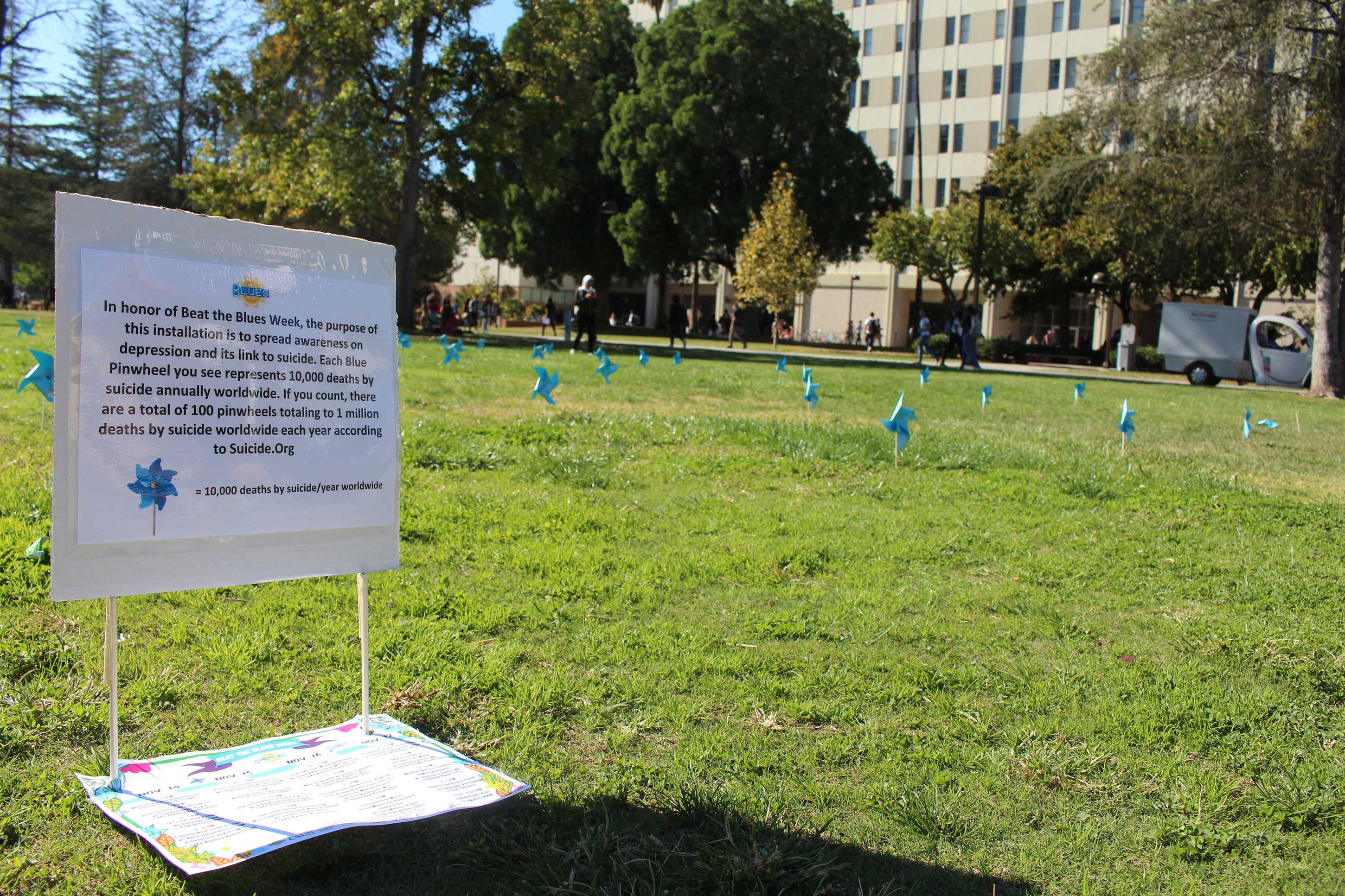 A Beat the Blues sign is shown next to blue pinwheels near Sierra Hall