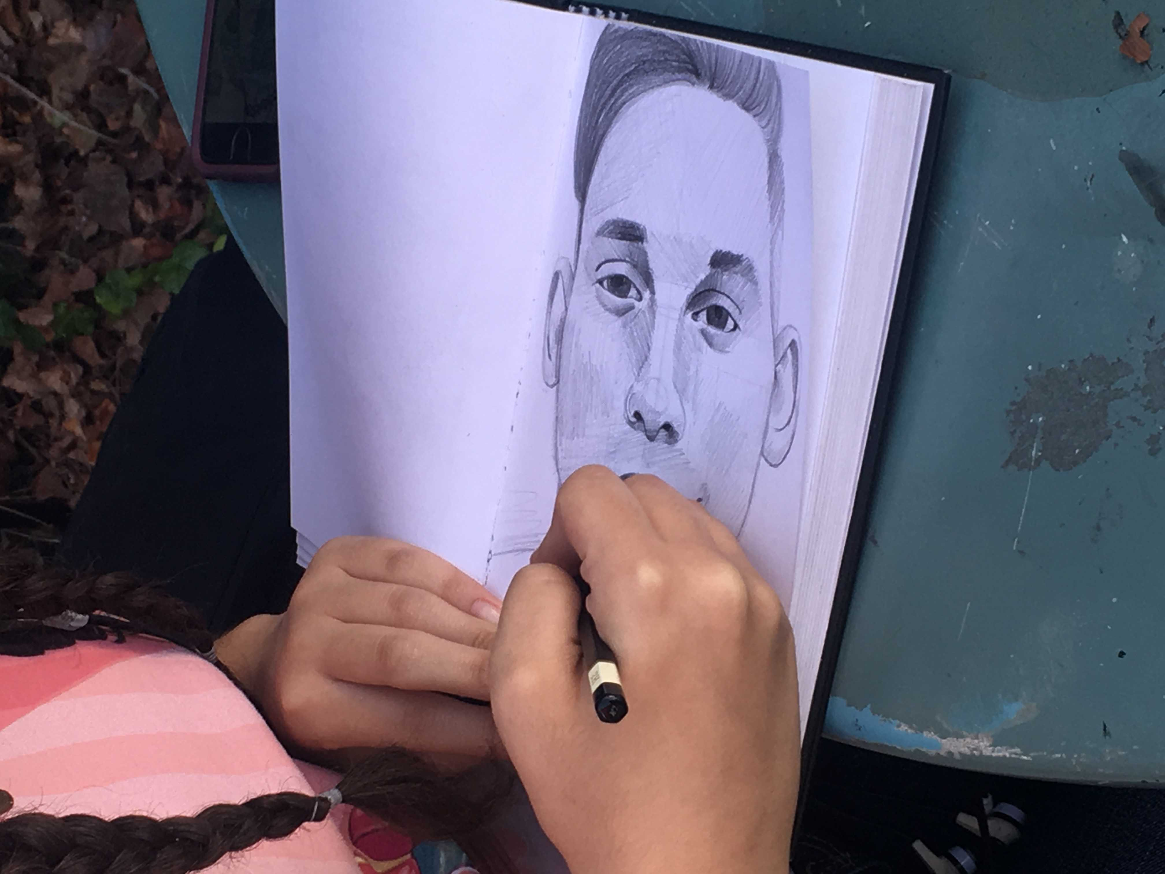 Student+pictured+drawing+realistic+portrait