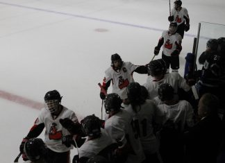Hockey players congratulate one another