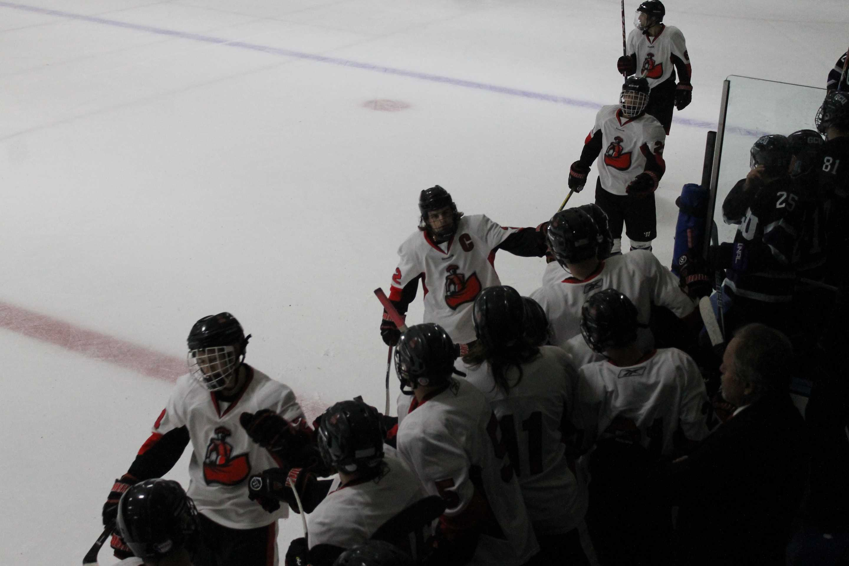 (12) Evan Wright, (22) Alex Reints, goal scorer, (25) Eli Berengut, and (6) John Michael Laurin receive praise from their team as this line got CSUN a 1-0 lead in the first against GCU Friday night at the Iceoplex in Simi Valley. (Solomon Ladvienka/The Sundial)