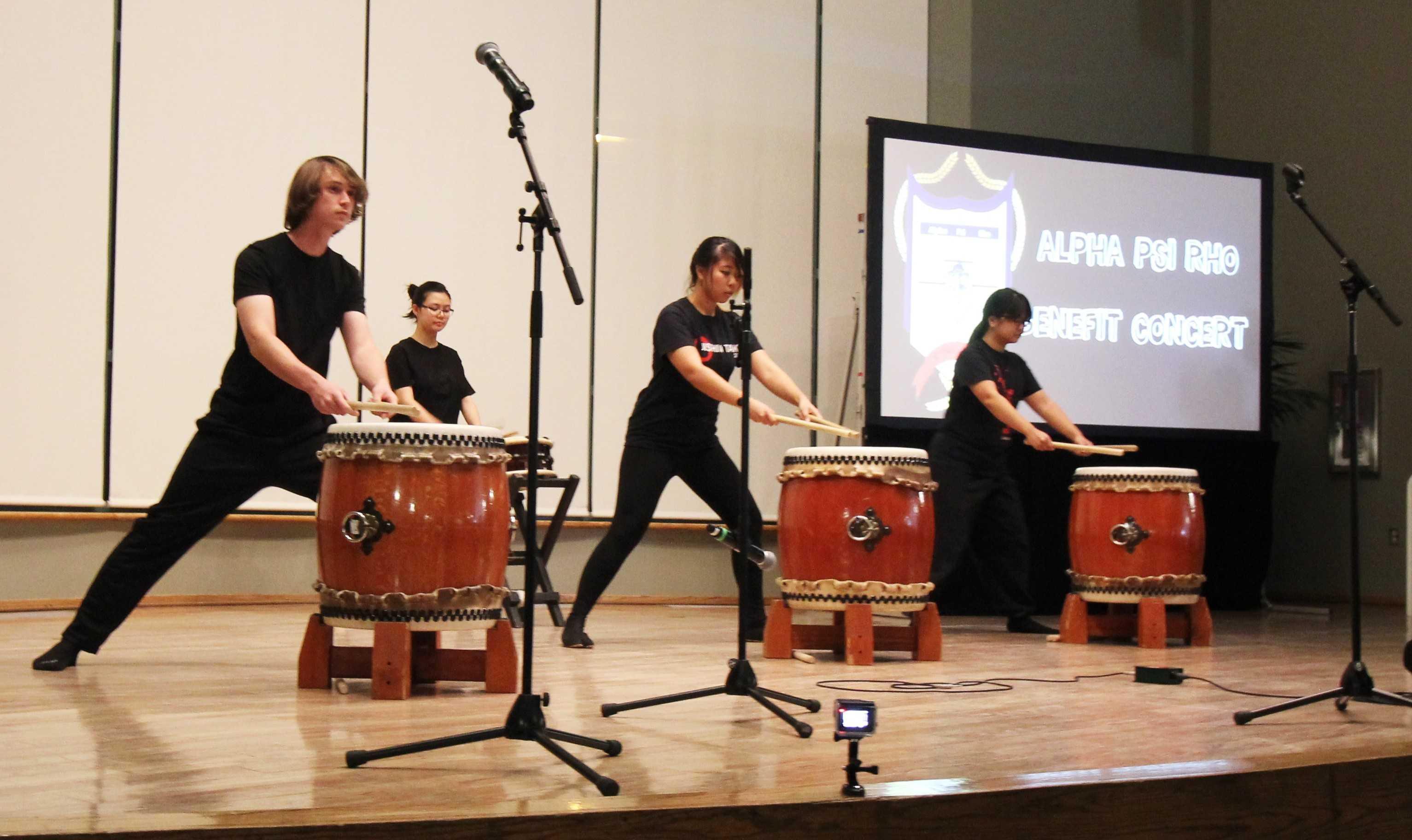 4+members+of+Jishin+Taiko+of+CSUN+play+the+drums