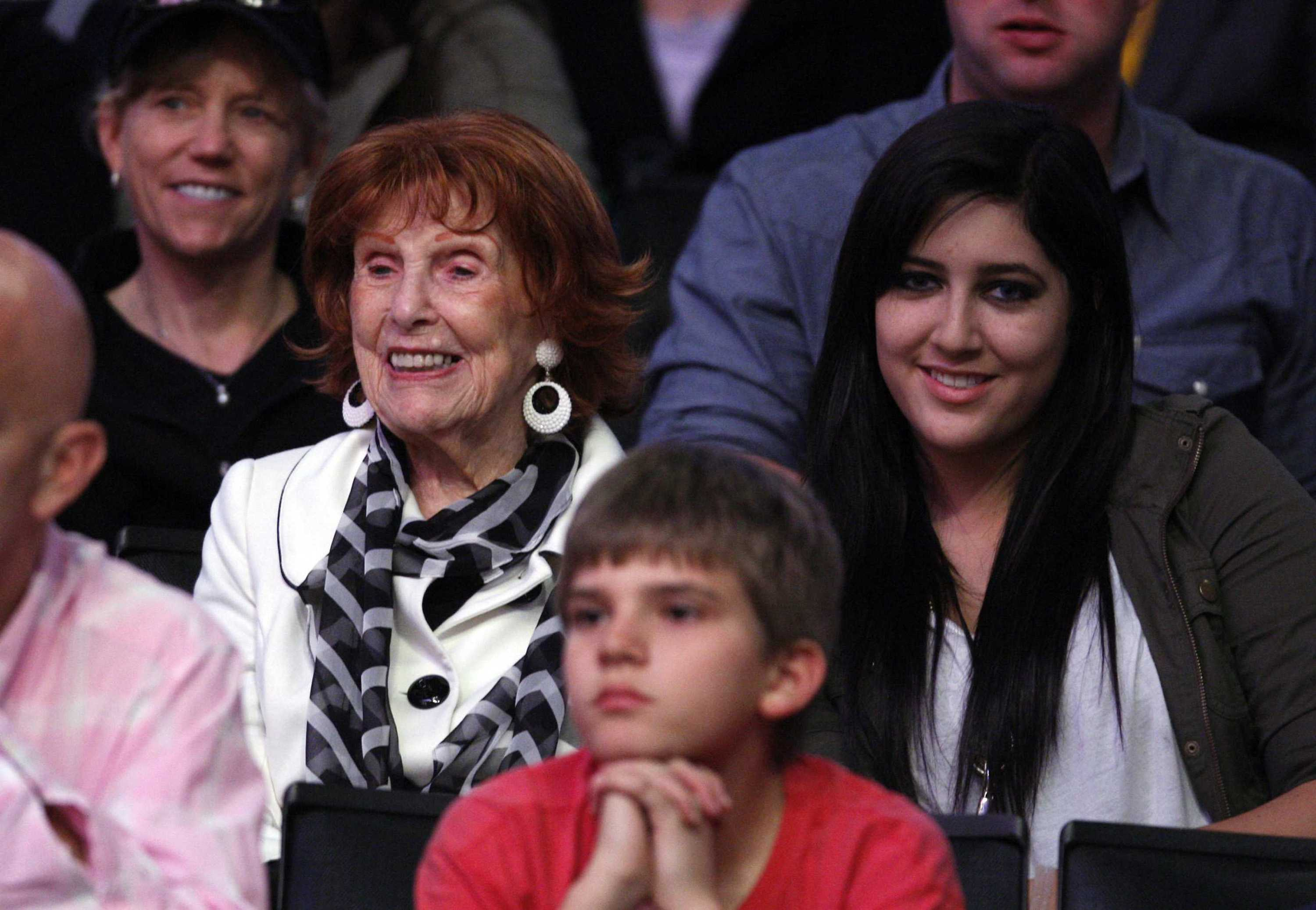 Marge Hearn, 94, left, widow of Los Angeles Lakers spotscaster Chick Hearn, watches the Lakers play the New Orleans Hornets with her great granddaughter, Kayla Hearn, at the Staples Center in Los Angeles, California, on March 27, 2011. (Allen J. Schaben/Los Angeles Times/MCT) Photo credit: MCT