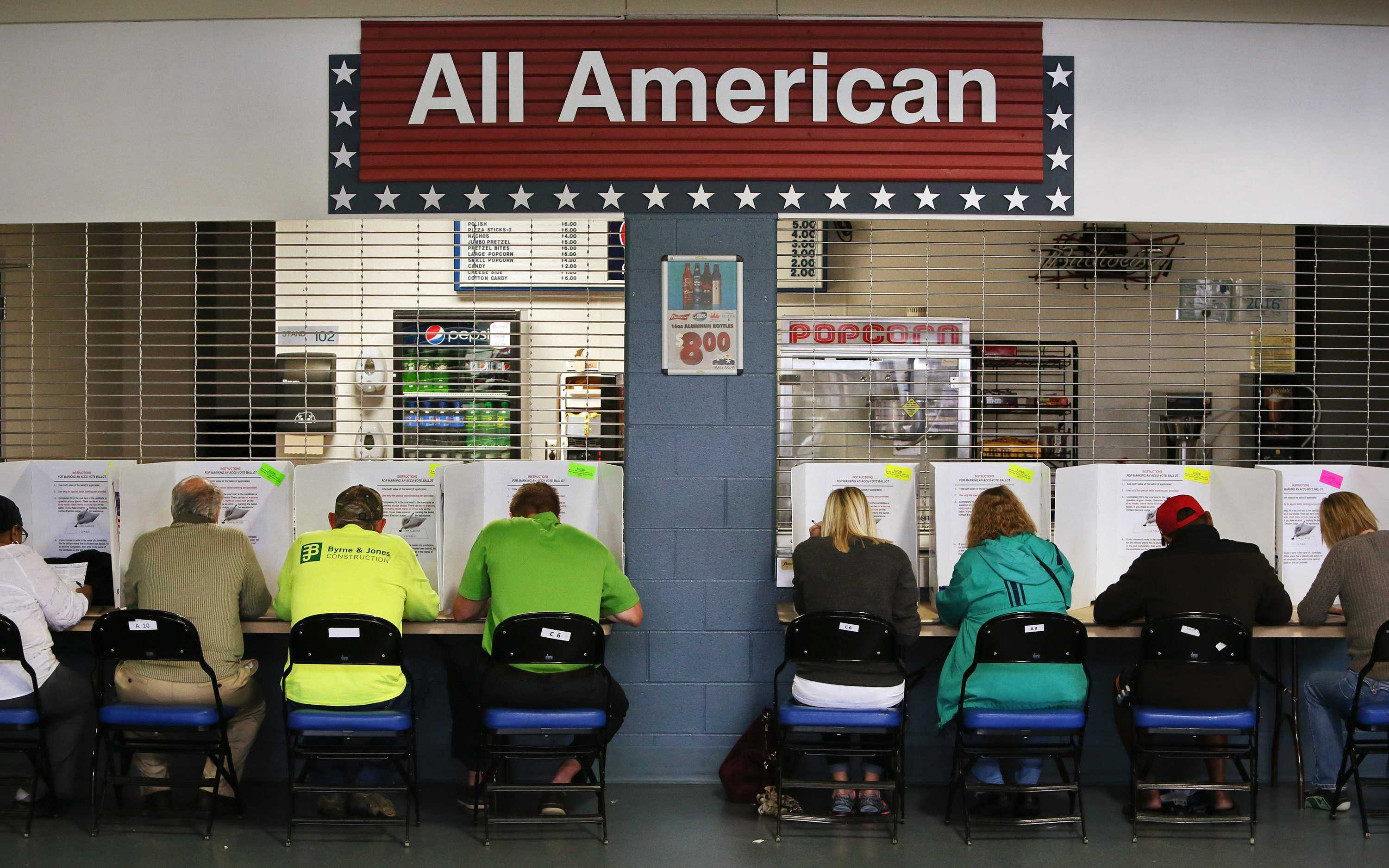 Voters fill out their ballots on Tuesday, Nov. 8, 2016 by a concession stand at the Precinct 16 polling station at the Family Arena in St. Charles, Mo.  (Chris Lee/St. Louis Post-Dispatch/TNS)