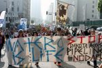 """Protesters march with large sign that reads, """"Water is life, stop Dakota Access Pipeline"""""""