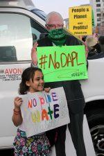 "Bernie Sanders cardboard cutout hold a sign that says, ""# no d.a.p.l."""