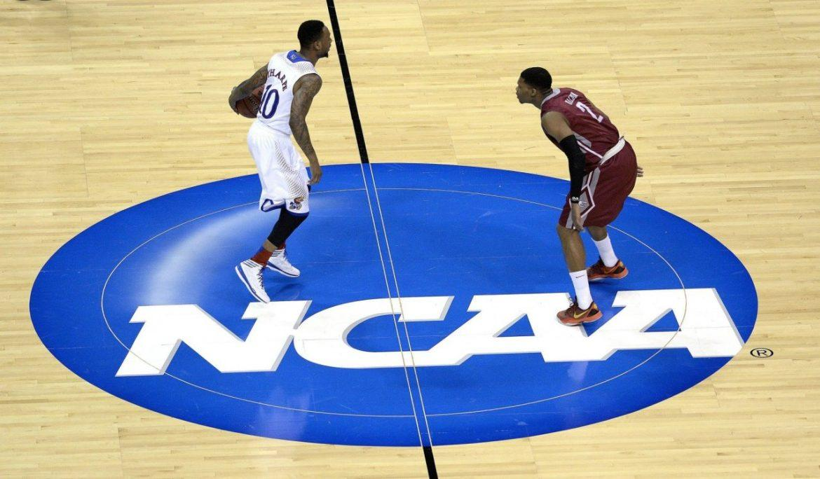 Kansas Jayhawks guard Naadir Tharpe (10) brings the ball through half court as Eastern Kentucky guard Corey Walden (2) defends during an NCAA Tournament game in St. Louis, Friday, March 21, 2014. (John Sleezer/Kansas City Star/MCT)