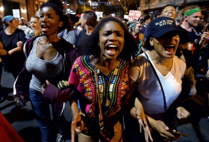 Protesters chant,