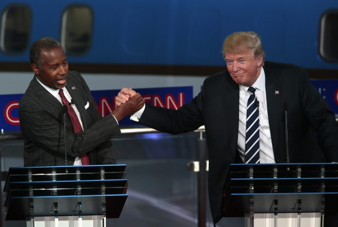 Ben Carson shakes hands with Donald Trump
