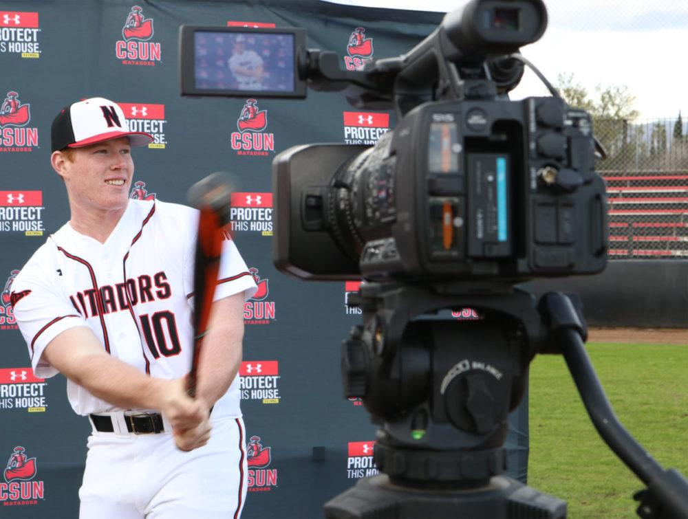 Albee Weiss swings his bat for a video that will appear on the jumbotron when he plays a game during Media Day at the baseball field on Tuesday, Jan. 24. Photo credit: Nikolas Samuels