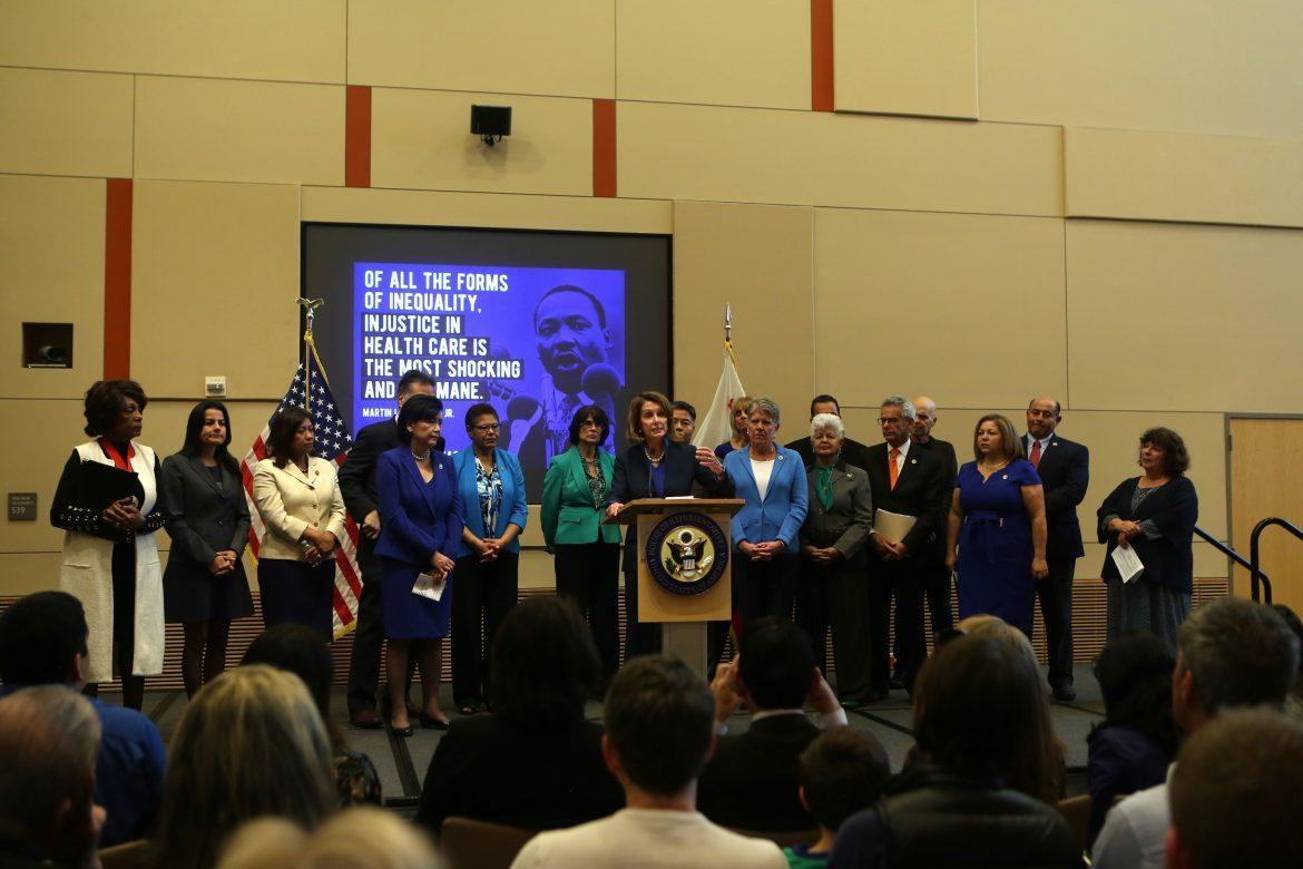 Nancy+Pelosi+speaks+to+an+audience+to+protect+Obamacare