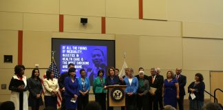 Nancy Pelosi speaks to an audience to protect Obamacare