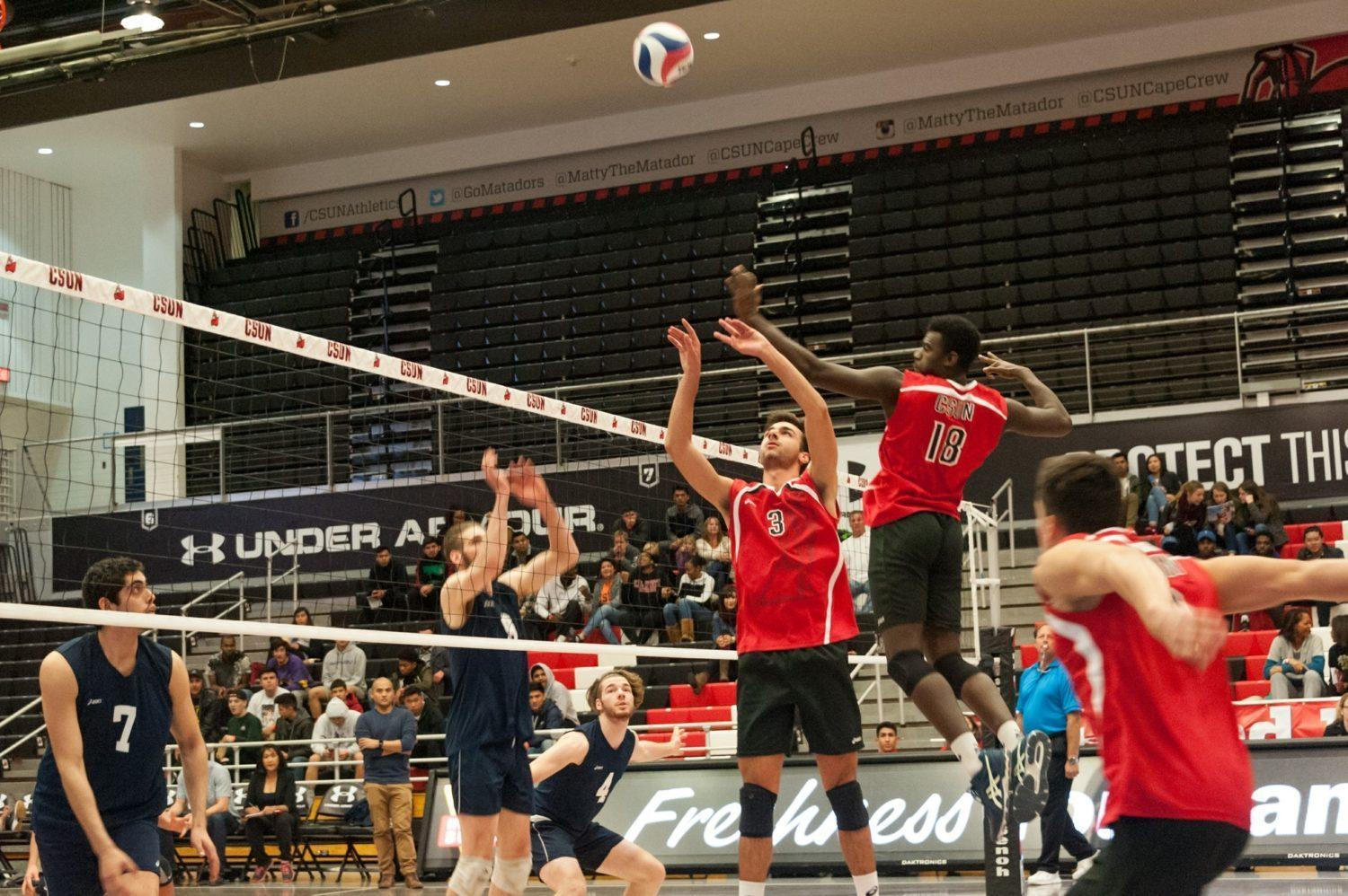Sophomore, Sam Porter (3), sets up the spike for middle blocker, Josiah Byers (18), over Hope international Friday Night at the Matadome. The Matadors added another victory to their 7-3 record with a three set victory against the Royals. Photo credit: Luis Garcia