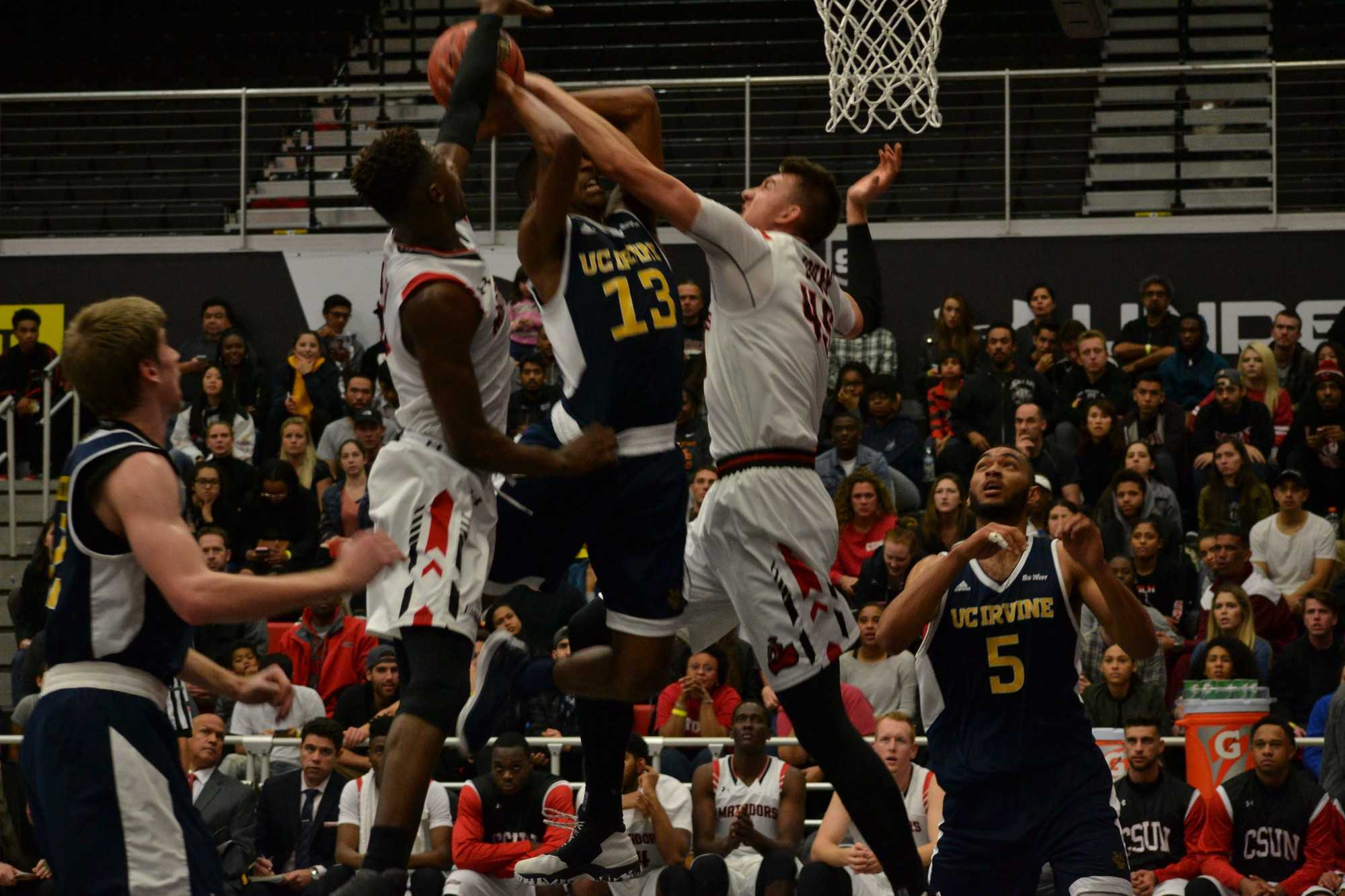 CSUN'S Junior forward, Tavrion Dawson(left) and CSUN'S Junior center, Dylan Johns(right), working together to defend a UC Irvine player at the game on Saturday, January 21st. Photo credit: Breaunne Pinckney