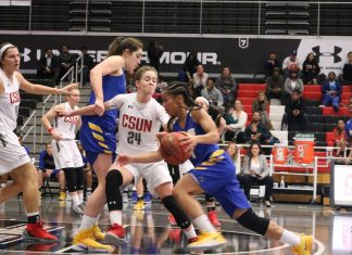 UCSB has the ball at center court and CSUN player is blocking her