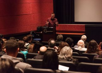 Tim Halloran gives a presentation in the Armer Theater