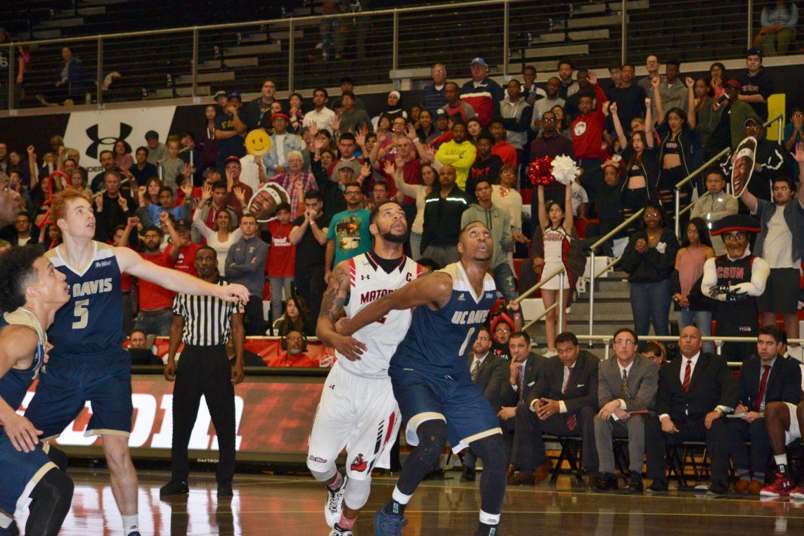 CSUN's Senior guard, Aaron Parks, waiting for the rebound while being guarded by a UC Davis player at the game on Saturday, Jan. 14th. Photo credit: Breaunne Pinckney