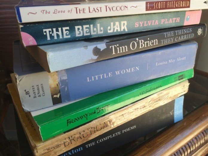 Picture shows a stack of several different books