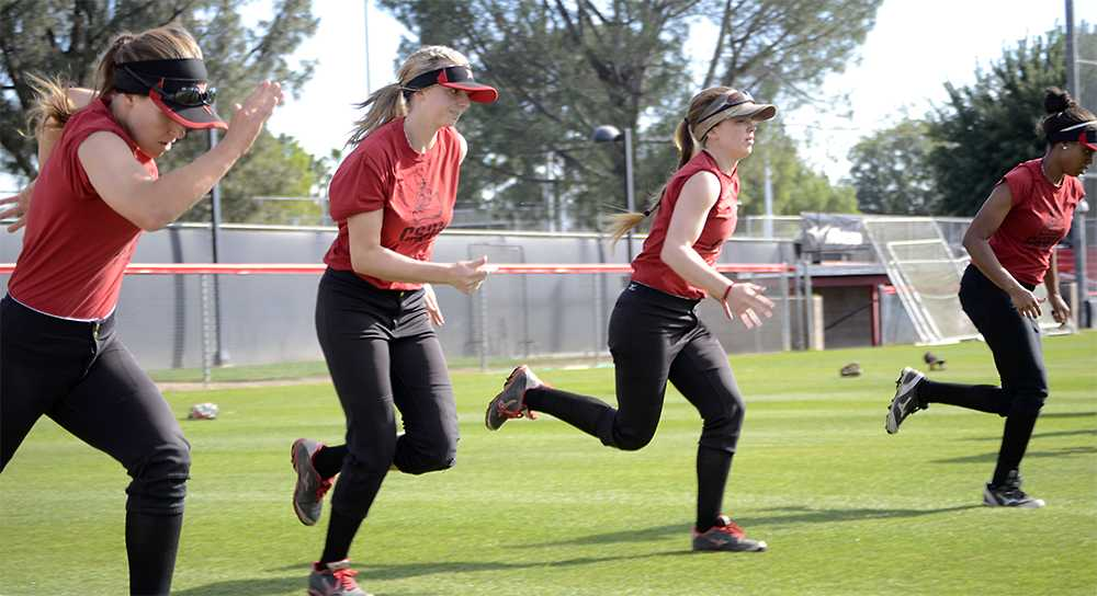 CSUN+softball+team+participates+in+warm-up+exercises
