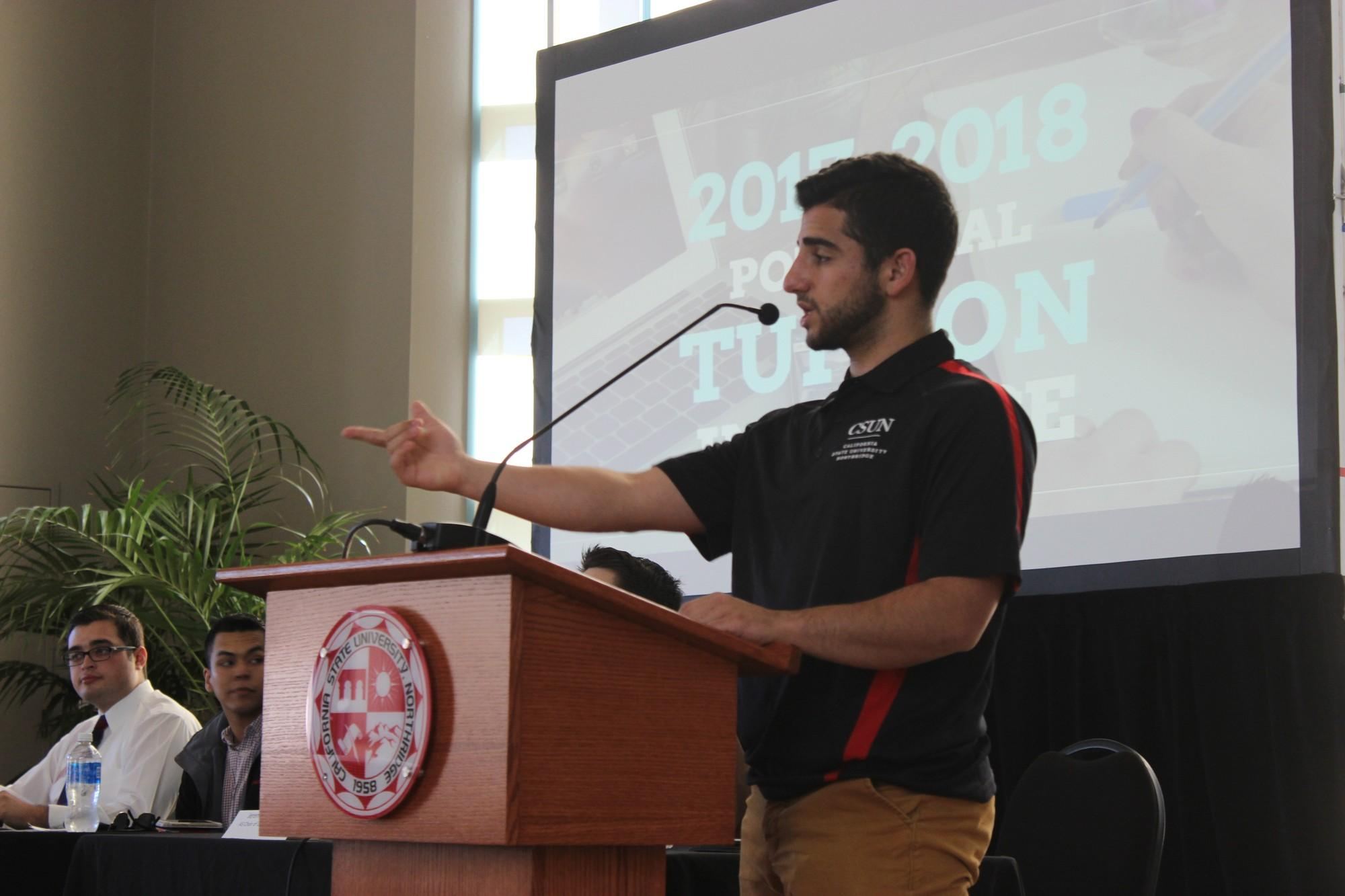 Sevag Alexanian, president of CSUN's Associated Students, opening up a panel discussion for a Town Hall  on possible CSU tuition increases Nov. 22 at the campus' Grand Salon. ( Robert Spallone / The Sundial)