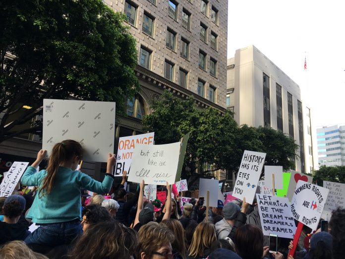 Protesters hold up a wide variety of signs