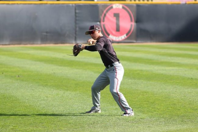 Fred Smith practicing his new position at shortstop a few days before the home opener. Photo Credit: Brianna Rendon/The Sundial