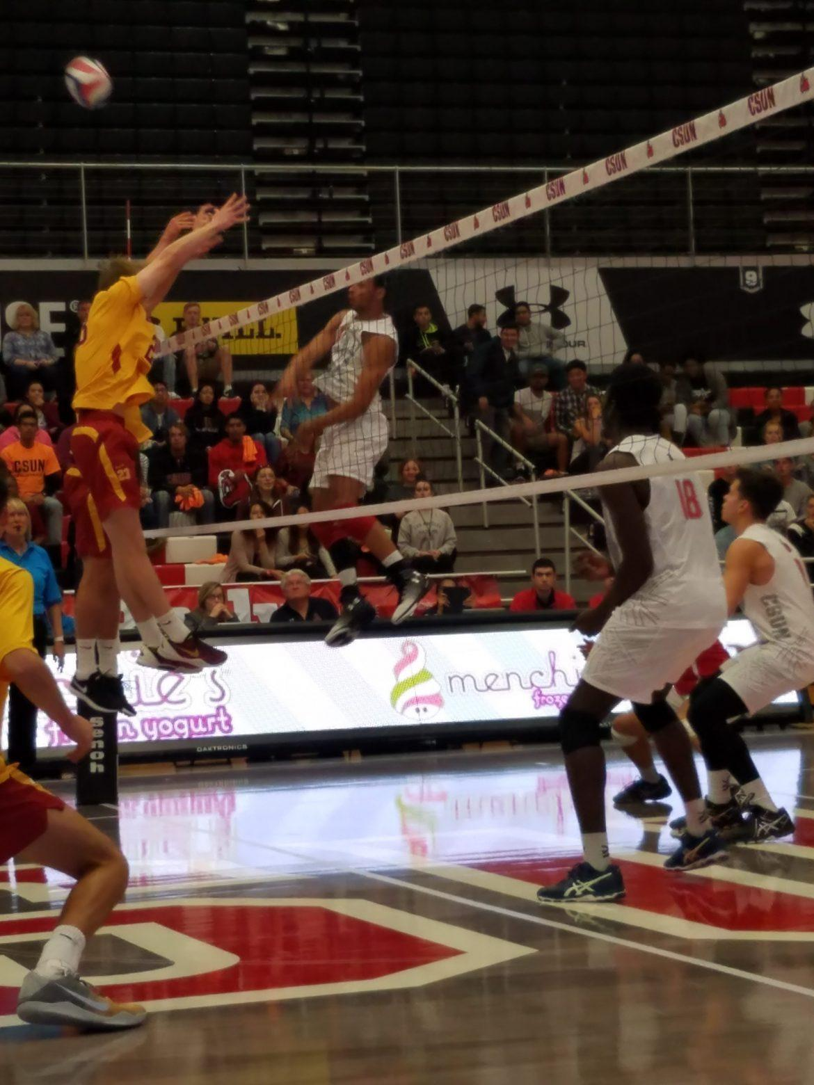 CSUN+volleyball+player+hits+the+ball+across+the+court