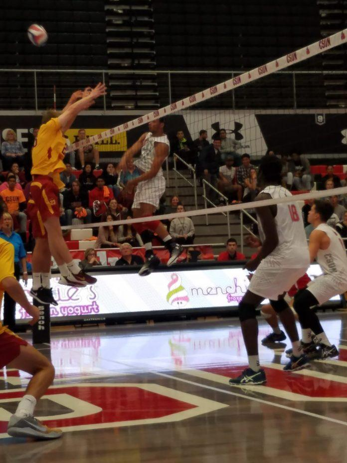 CSUN volleyball player hits the ball across the court