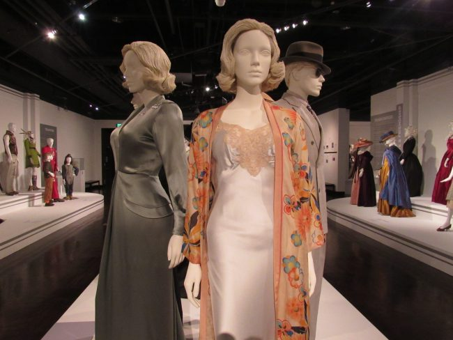 Movie costumes displayed in gallery