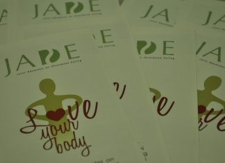 """pamphlets saym """"love your body"""""""