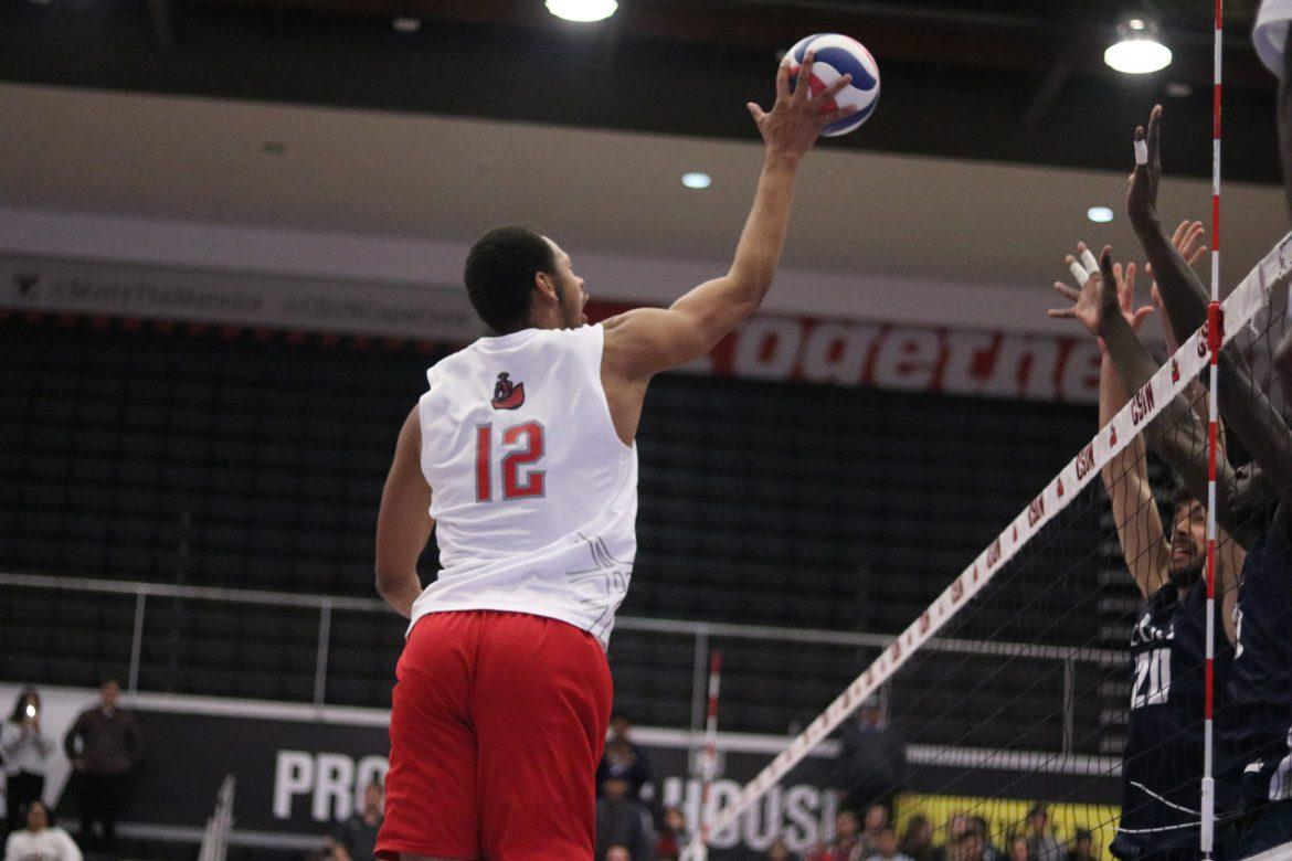 CSUN's junior opposite hitter, Arvis Greene Jr., spikes the ball while being double blocked by the Cal Baptist Lancers on Friday, Feb. 24, at the Matadome. Photo Credit: Lauren Valencia/The Sundial