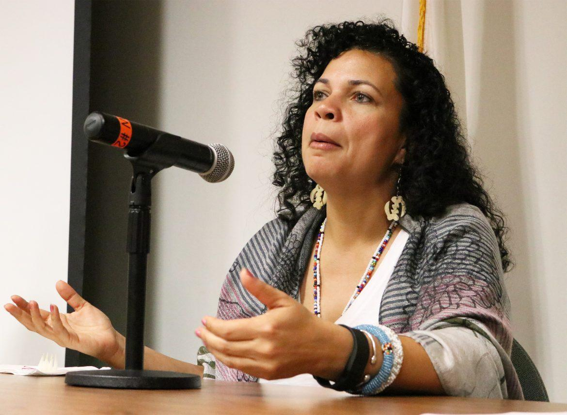 Melina Abdullah, Ph.D, a Black Lives Matter leader and professor at Cal State University Los Angeles, leads a discussion that followed a screening of 13th, a Netflix orginal movie about prejudice in the American prison system, on Wednesday at the Jack and Florence Ferman Presentation Room in Oviatt Library. Photo credit: Nikolas Samuels