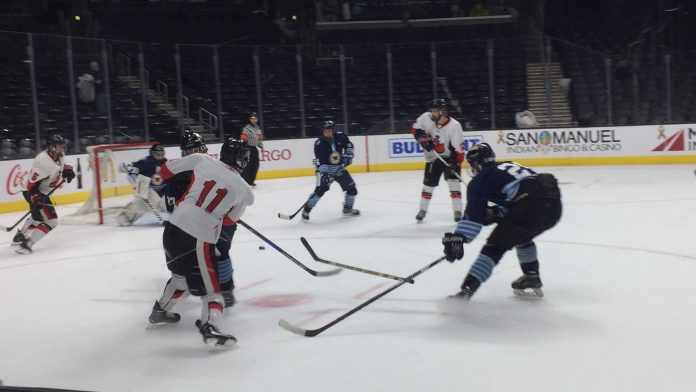Player hits the puck