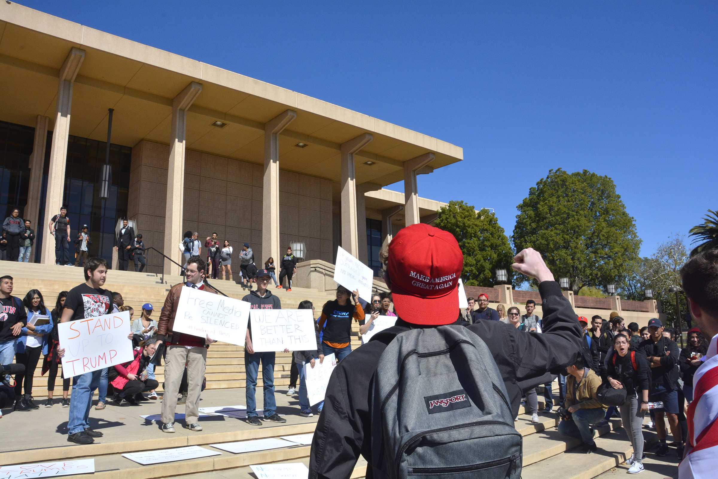 Trump supporters along with anti-trump protesters gather on the Oviatt lawn. Photo credit: Marja Ziemer