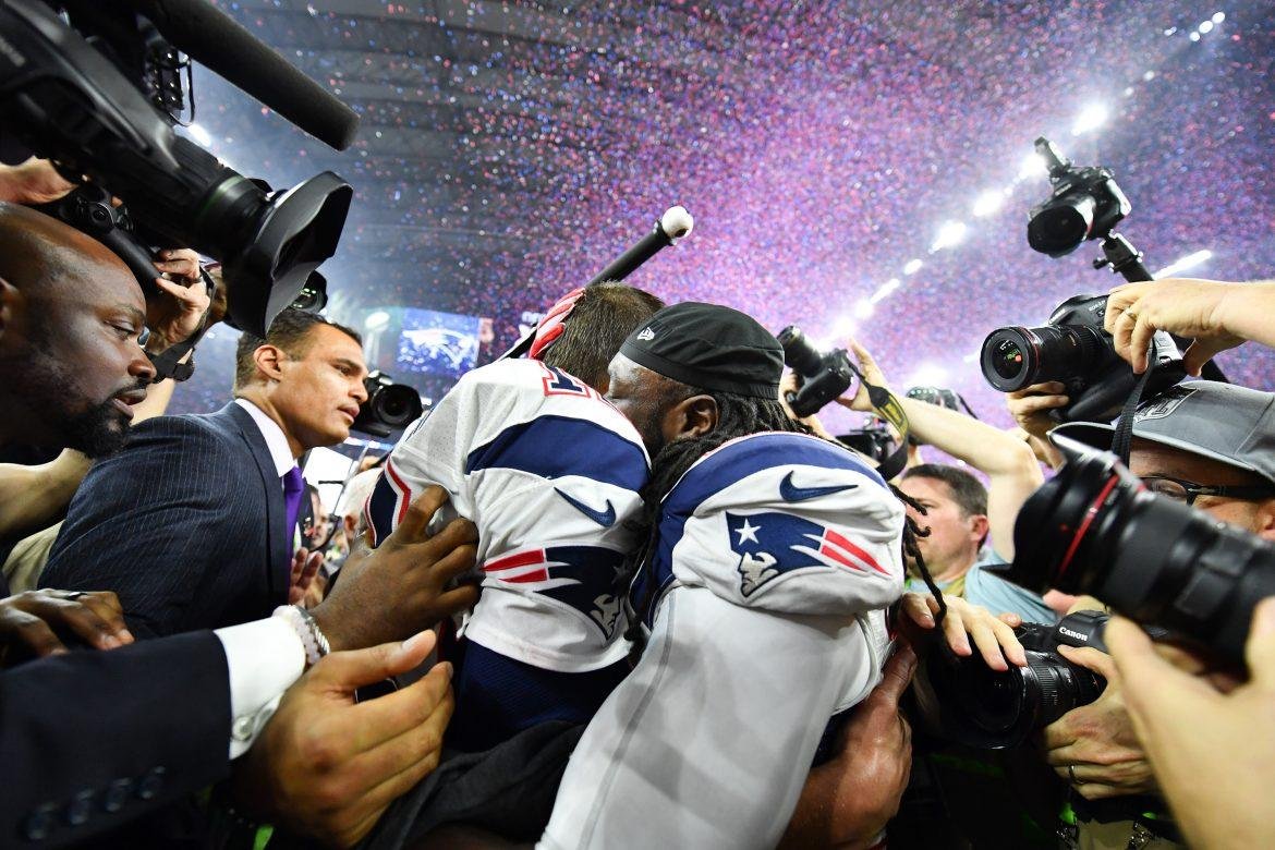 New England Patriots quarterback Tom Brady (12) and New England Patriots running back LaGarrette Blount (29) celebrate during the post-game ceremony for Super Bowl LI after they defeated the Atlanta Falcons 34-28 in overtime on Sunday, Feb. 5, 2017 at NRG Stadium in Houston, Texas. (Anthony Behar/Sipa USA/TNS)