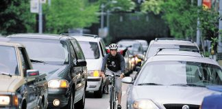 photo shows woman biking to work