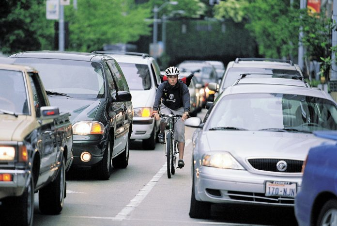 photo shows woman biking to work