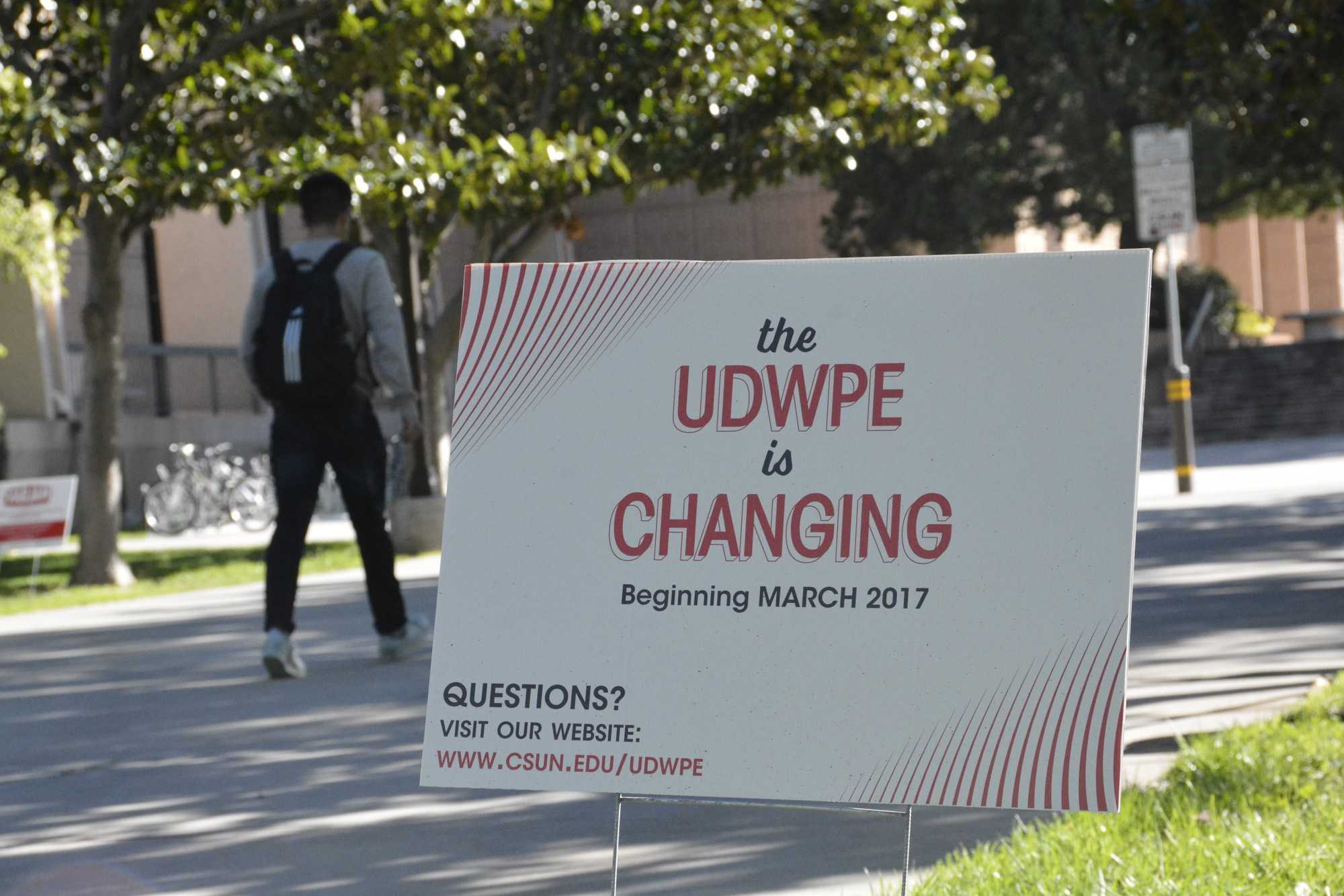 "sign located on CSUN campus reads, ""the UDWPE is changing"""