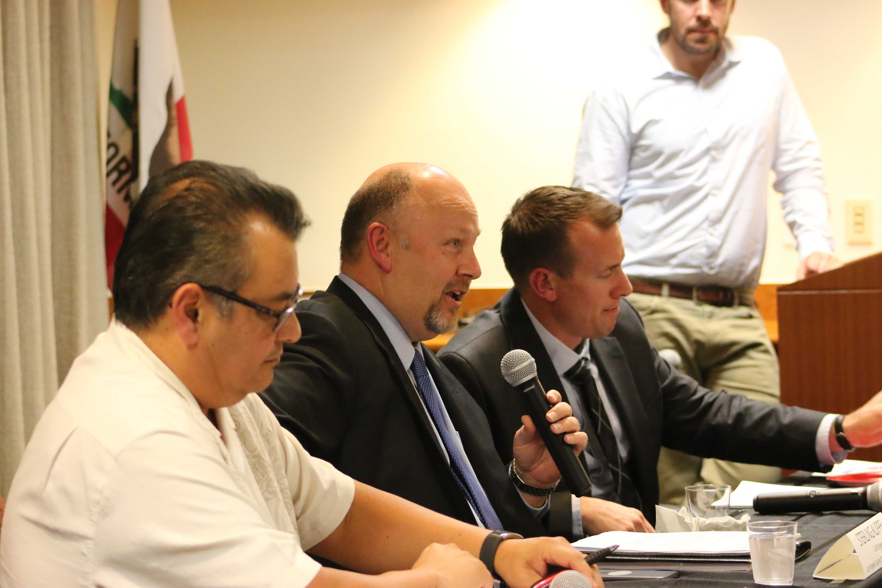 Ortega and Klippel discuss the goundwater movement at panel
