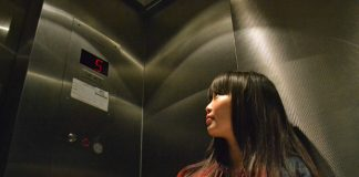 Photo shows woman in an elevator on level five