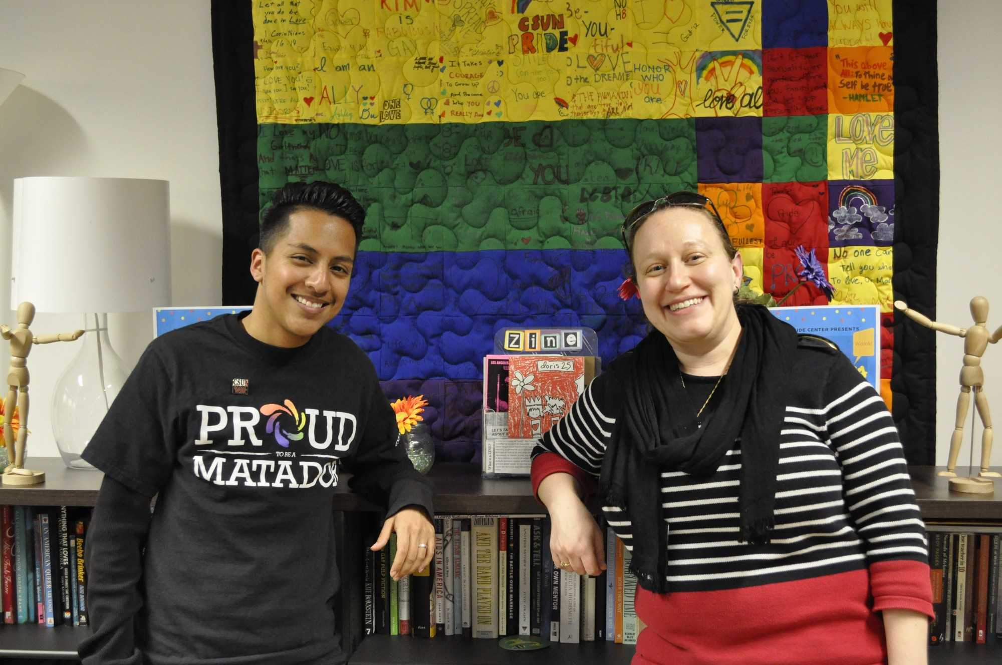 two students pose for a picture in the pride center