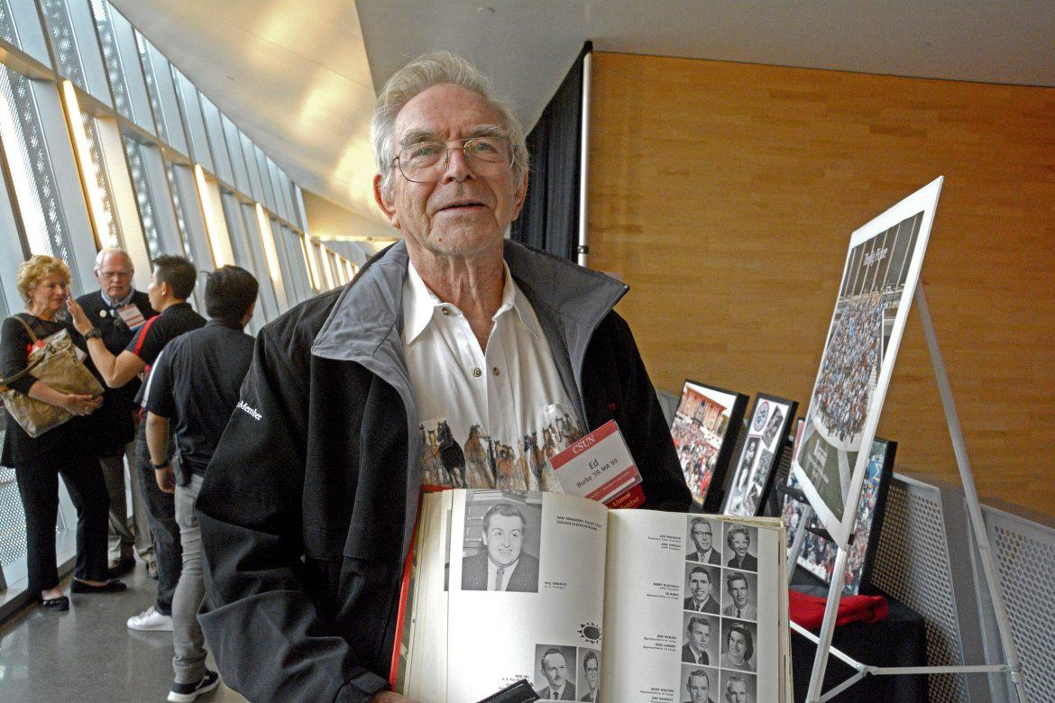 CSUN+Alumni+Ed+Burke+holds+his+class+Yearbook+from+1959+during+Homecoming+at+the+SRC.+Photo+credit%3A+Ivan+Salinas