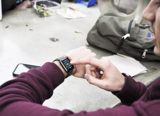 Student pictured while using his smartwatch