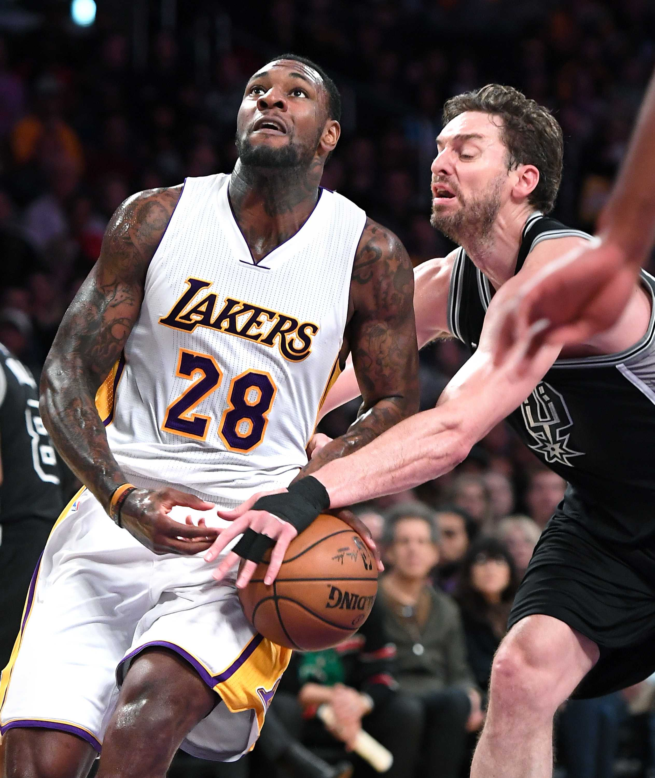 Los Angeles Lakers' Tarik Black has the ball knocked away by San Antonio Spurs' Pau Gasol while driving to the basket on Sunday, Feb. 26, 2017 at the Staples Center in Los Angeles, Calif. (Wally Skalij/Los Angeles Times/TNS)