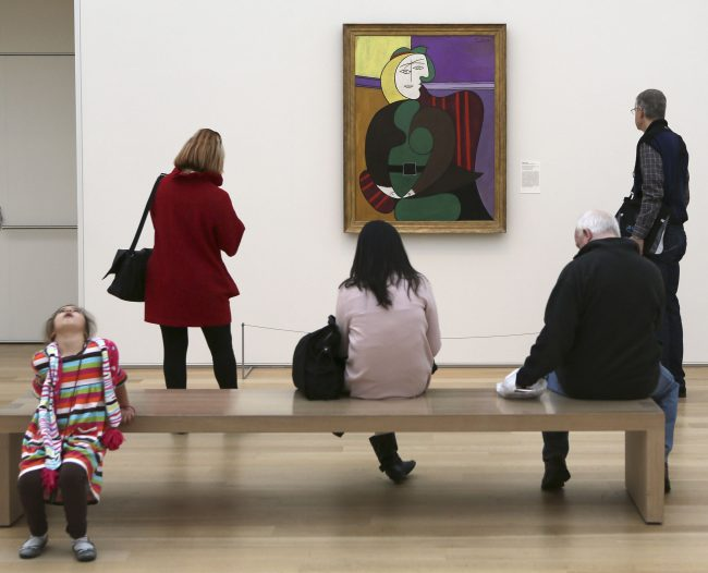 Several people stand in front of picasso's