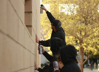 "Students used cans of compressed air to ""clean the exterior walls of The Sundial"""