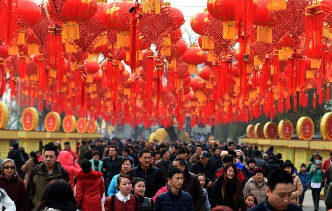 There are hundreds of bright red lanterns strung high above the crowd of people for the lunar new year celebration