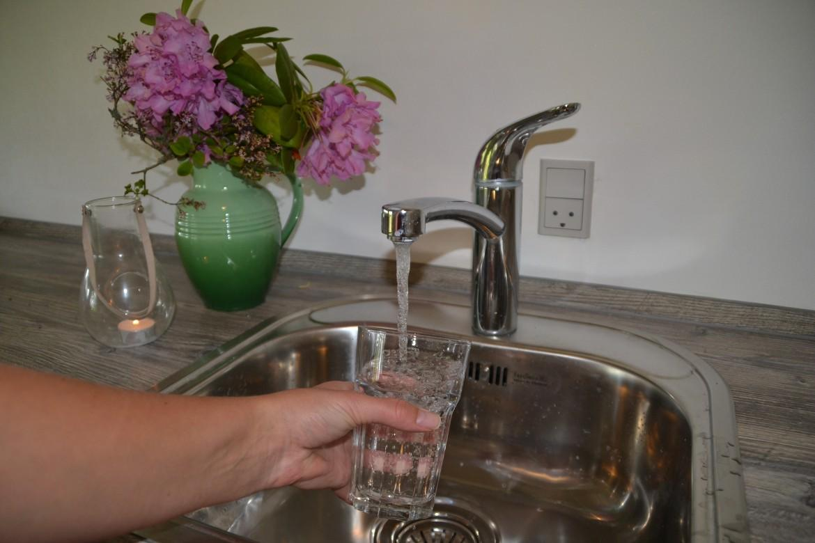 Pouring a glass of tap water. Photo credit: Trine Bay Larsen
