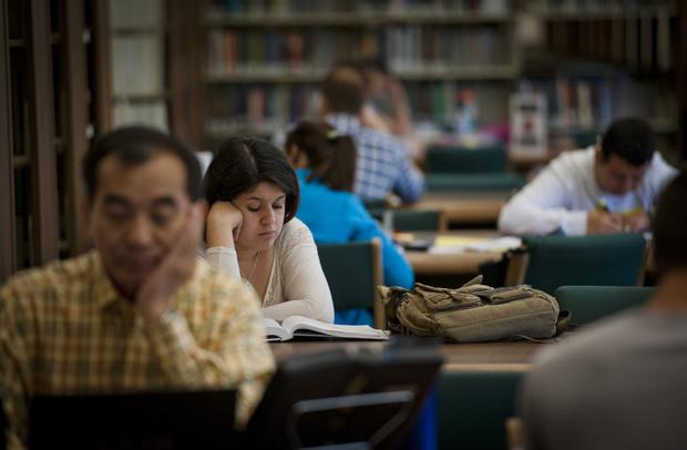 students pictured sitting at desks in the Oviatt Library