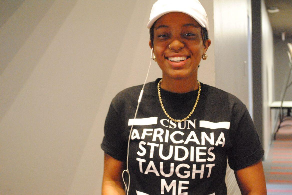 woman+wears+a+t-shirt+which+reads%2C+%22csun+africana+studies+taught+me%22