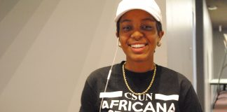 "woman wears a t-shirt which reads, ""csun africana studies taught me"""